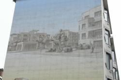 Fresque représentant des habitations en communs