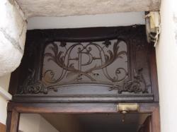 Imposte à monogramme, 58 rue Mercière