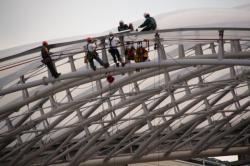 Travailleurs sur les toits